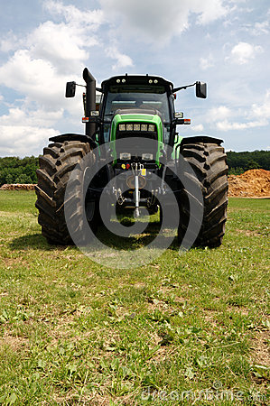 Green tractor on grass