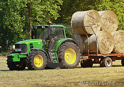 Green tractor at work Editorial Photography