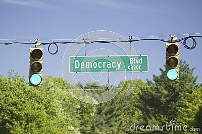 A green traffic light on Democracy Blvd