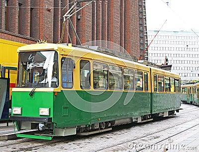 Green tram on street