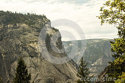 Green Trees Under Tall Gray Rocky Cliff Free Public Domain Cc0 Image
