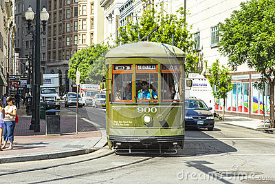 Green trolley streetcar on rail Editorial Stock Image
