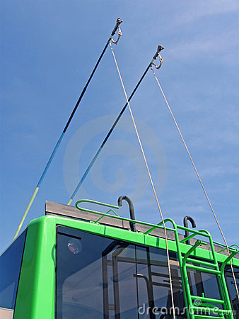 Green trolleybus bars on blue sky, transportation,