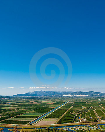 Green valley with clear blue sky