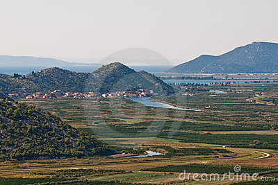 Green valley with sea and hills in distance