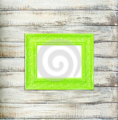 Green Vintage picture frame on old wood background