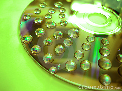 Green water drop on disk