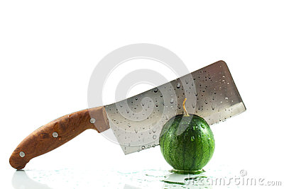 Green watermelon cuted by hatchet