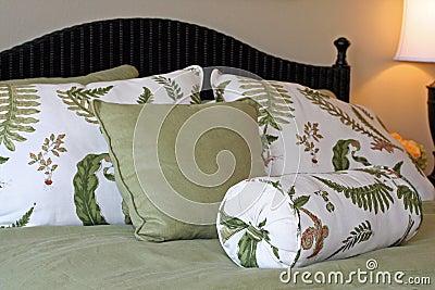 Green & white bedding, pillows