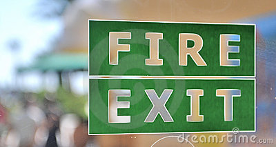 Green and white fire exit sign