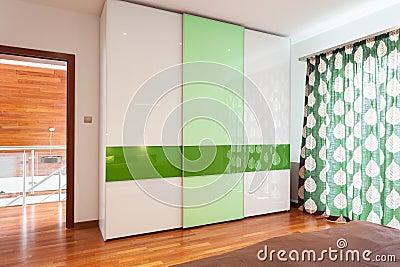 Green and white wardrobe