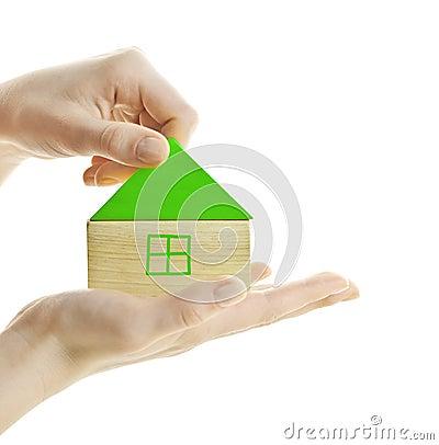 Green wooden block house