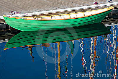 Green wooden row boat