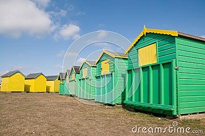 Green and yellow beach huts