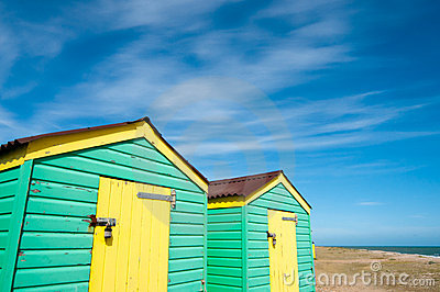 Green and yellow  beach huts in summer