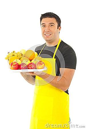 Greengrocer holding fruits