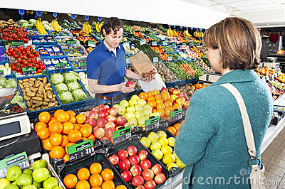 Greengrocer serving a customer