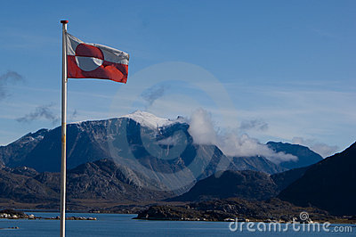 Greenland shoreline with flag
