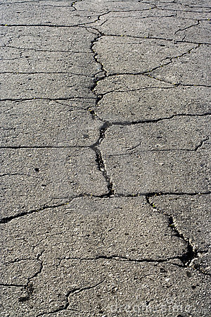 Grey asphalt road surface texture with fissure