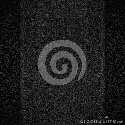 Grey canvas background on black leather