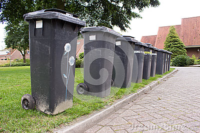 Grey garbage containers in a row