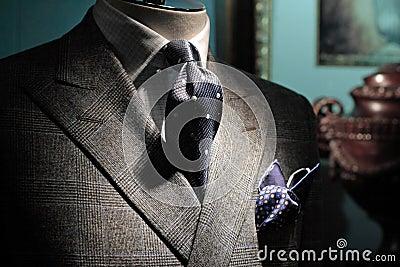 Grey jacket, dark blue tie and handkerchief