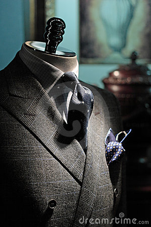 Grey jacket, dark blue tie and handkerchief