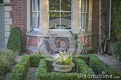 Grey Mountain Bike Leaning On Brown Wall Brick In Garden Free Public Domain Cc0 Image