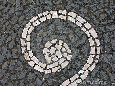 Grey paving with white spiral