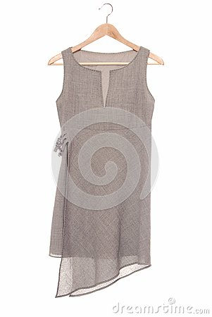 A grey tunic is on hanger.