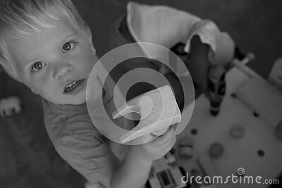 Greyscale Photo Of Boy On Tshirt Holding Brown Wood Free Public Domain Cc0 Image