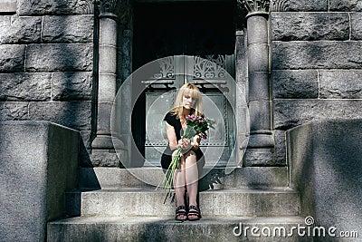 Grief: Woman Sitting on Mausoleum Steps