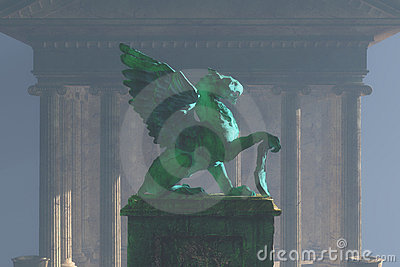 Griffin on pedestal in fog