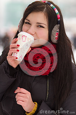Gril drinking coffee in iwinter