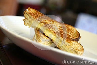 Grilled cheese on white plate
