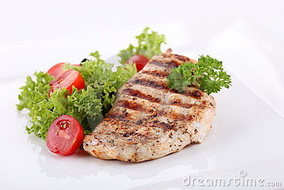 Grilled chicken breasts with fresh vegetables