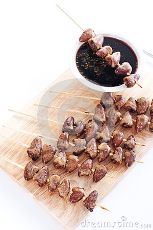Grilled chicken hearts on skewers