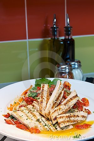 Grilled chicken over Italian pasta