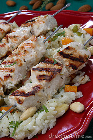 Grilled chicken skewers on rice