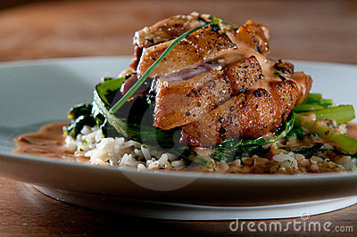 Grilled duck over wild rice