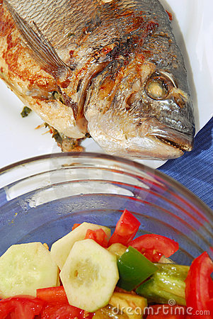 Grilled fish with salad.