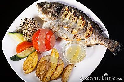 Grilled fish sea bream on barbecue Stock Photo