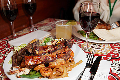 Grilled pork ribs, beef and shrimps
