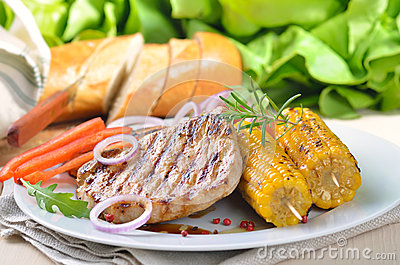 Grilled pork steak meal
