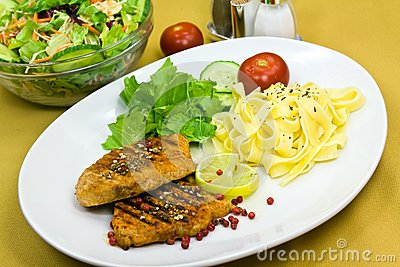 Grilled pork steak with noodles and lettuce