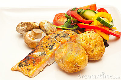 Grilled salmon with baked and fresh vegetables