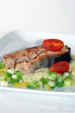 Grilled salmon fillet on mashed potato onion