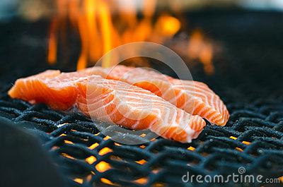 Grilled Salmon Steaks On A Grill Fire Flame Grill