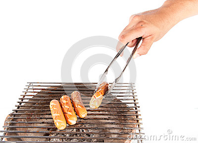 Grilled sausage over a hot barbecue grill