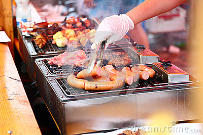 Grilled sausages and meat on the barbecue